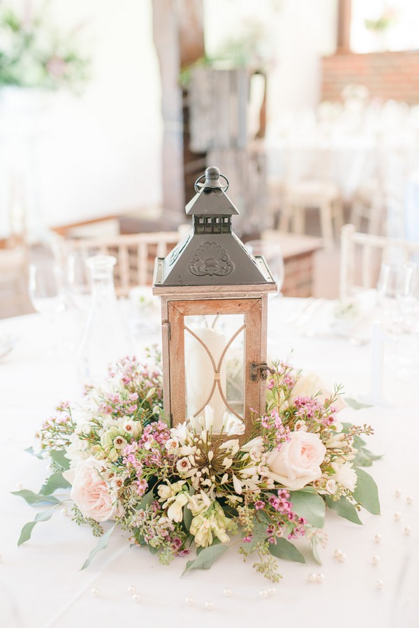 lantern wedding centerpiece with candle and flowers