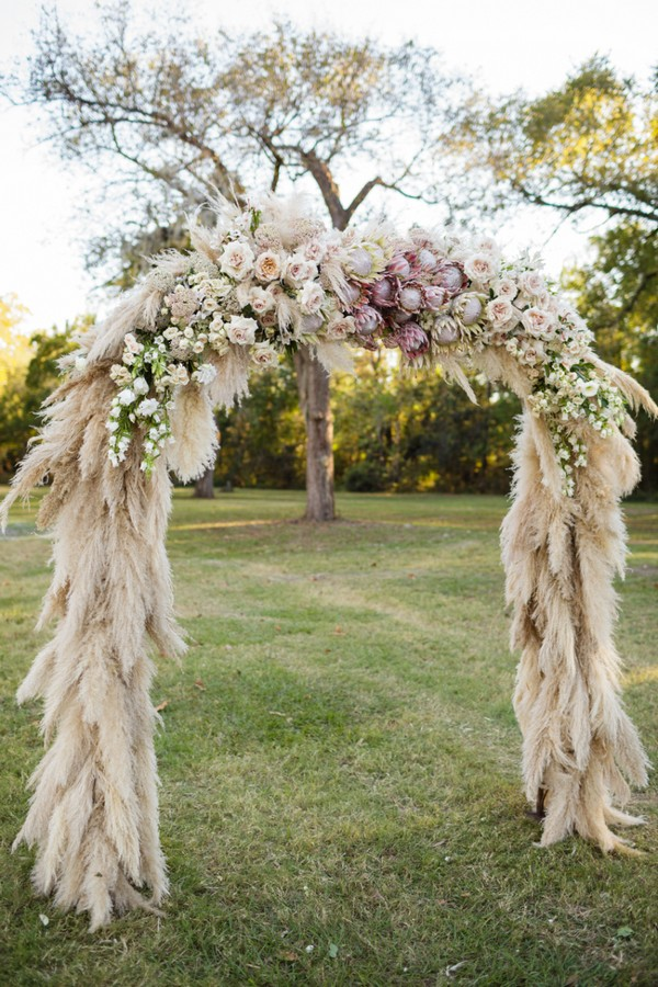 unique feather and flowers wedding arch ideas