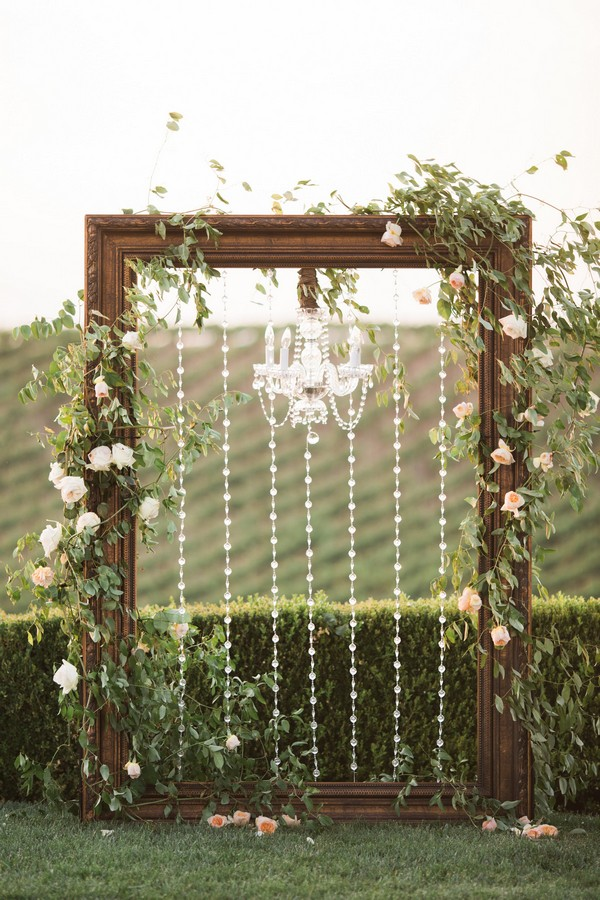 vintage frame and chandelier wedding arch decoration ideas