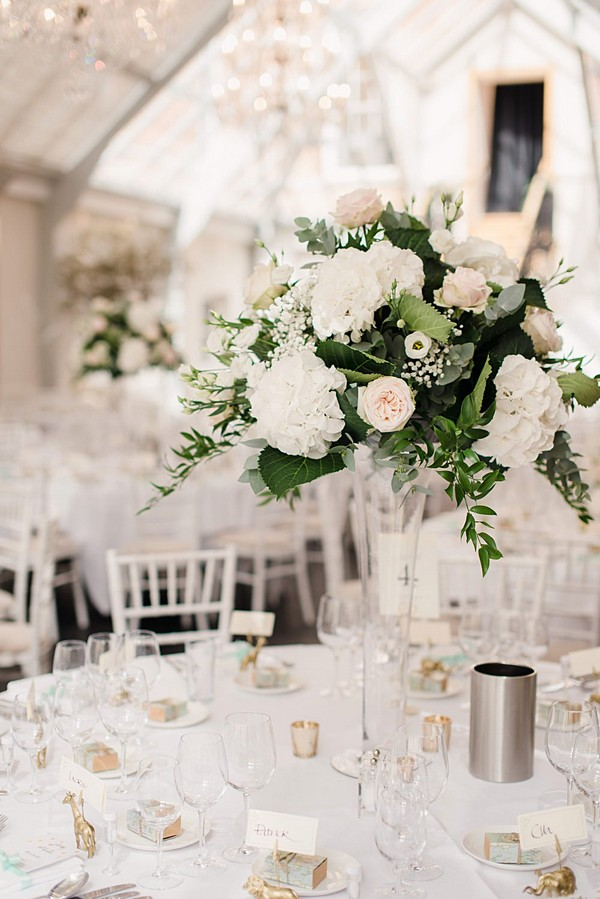 romantic tall wedding centerpiece with greenery and rose