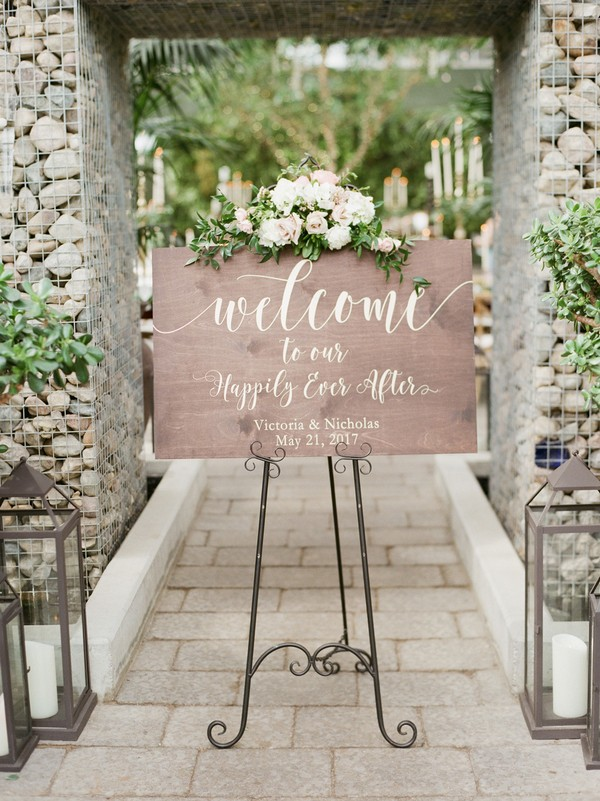 wedding sign ideas with pink and greenery decoration