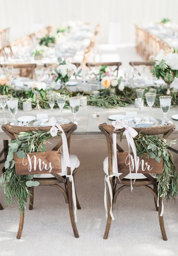 Mrs. and Mr. garland topped wedding sweetheart chairs