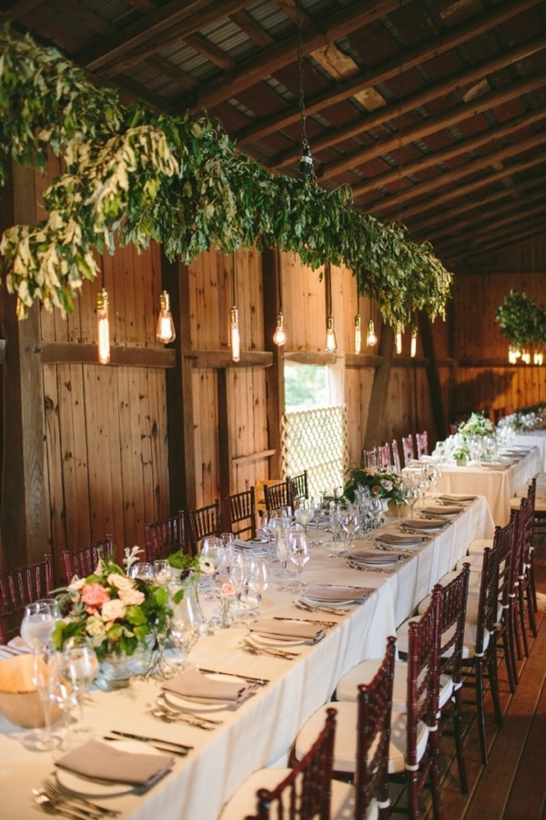 chic rustic wedding reception ideas with greenery and edison bulbs