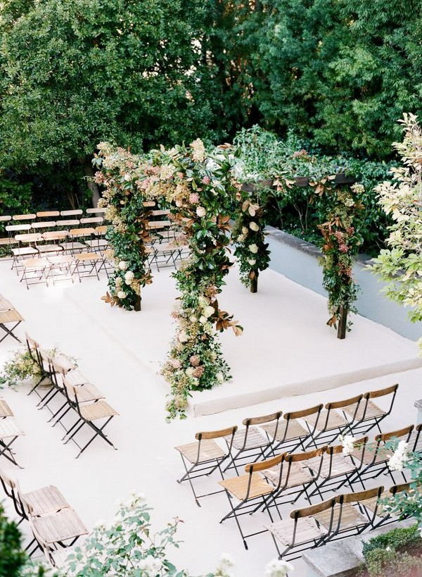 floral wedding arch ideas with chairs surrounded