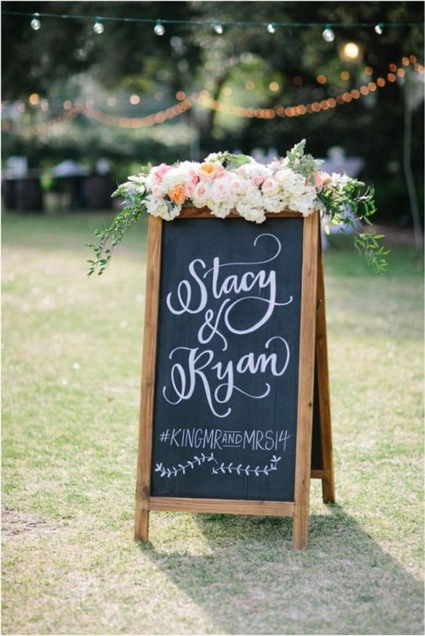 floral decorated chalkboard wedding sign