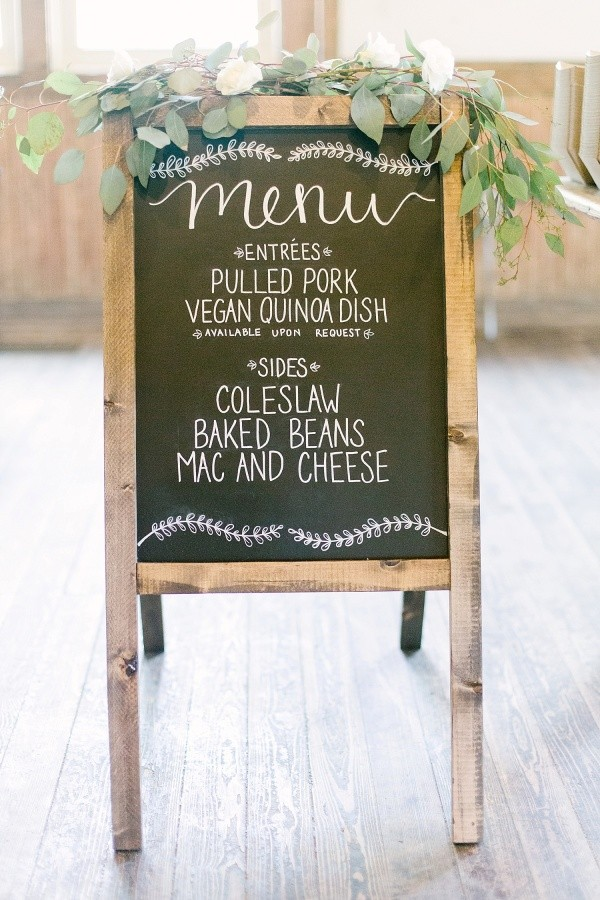greenery decorated chalkboard wedding sign