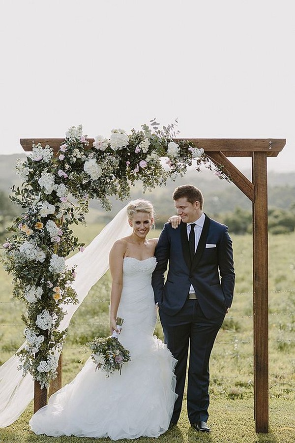 wedding alter decorations with cascading floral arrangement