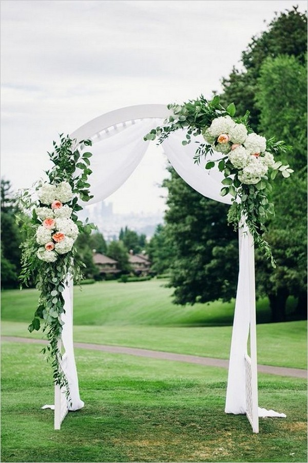 white and green wedding alter with a touch of peach