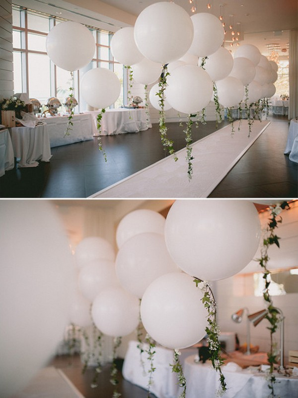 garland accented balloon wedding aisle decorations