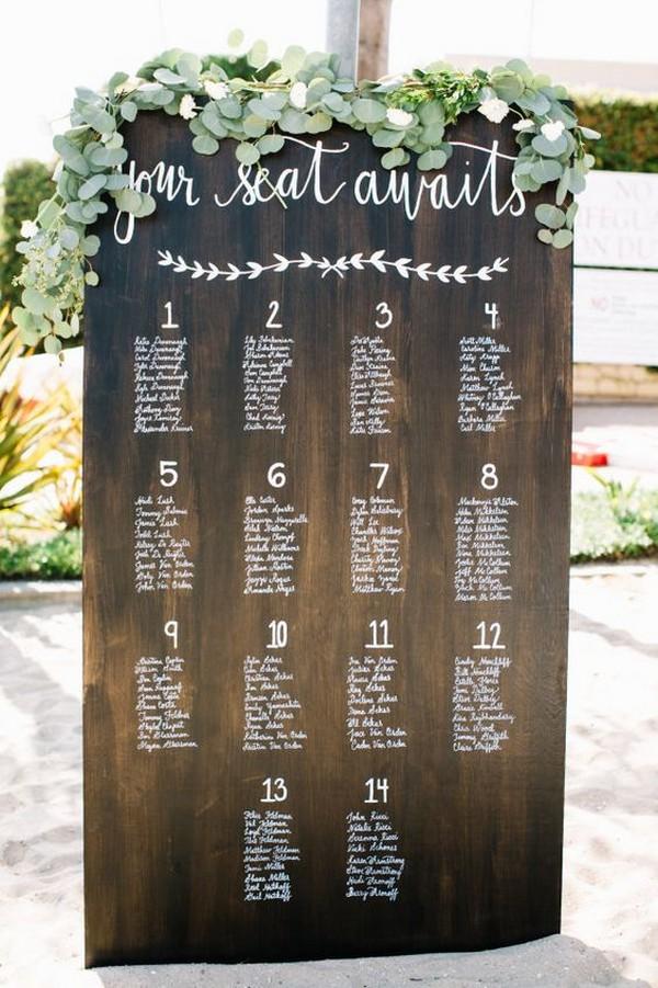 greenery and wooden wedding seating chart ideas - EmmaLovesWeddings