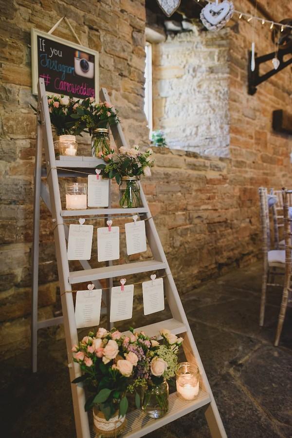 vintage wedding seating plan display with ladder