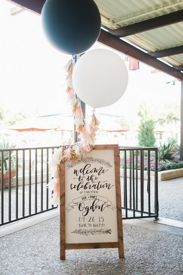 wedding sign decorated with balloons