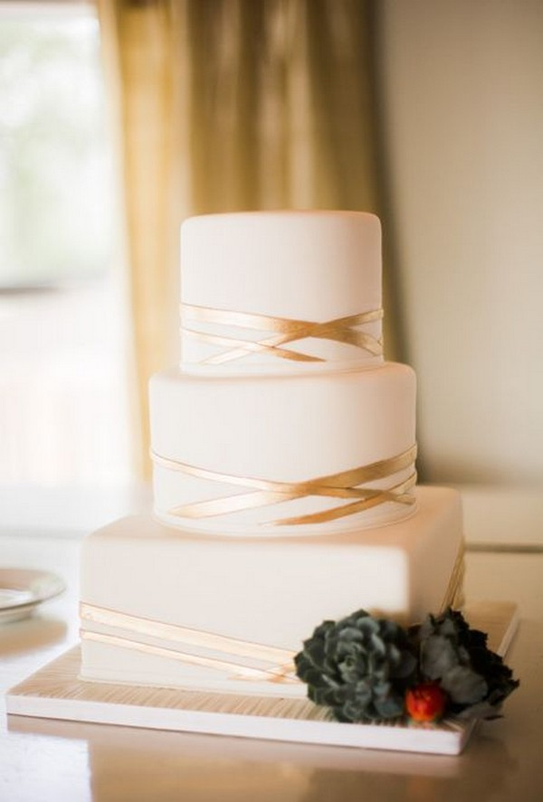 white and gold wedding cake simple but elegant