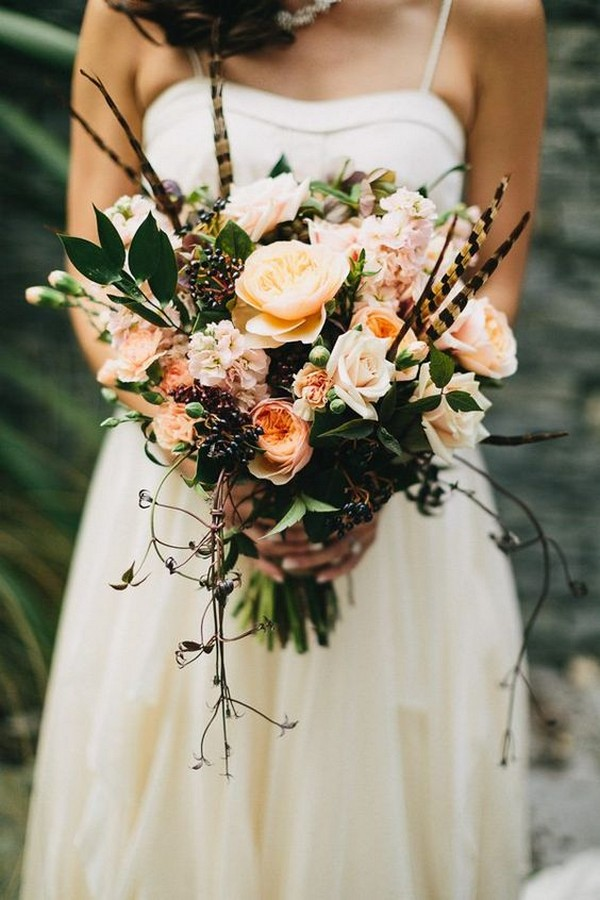 12 unique wedding bouquet ideas with feathers emmalovesweddings wild wedding bouquet with juliet garden roses and feathers junglespirit Gallery
