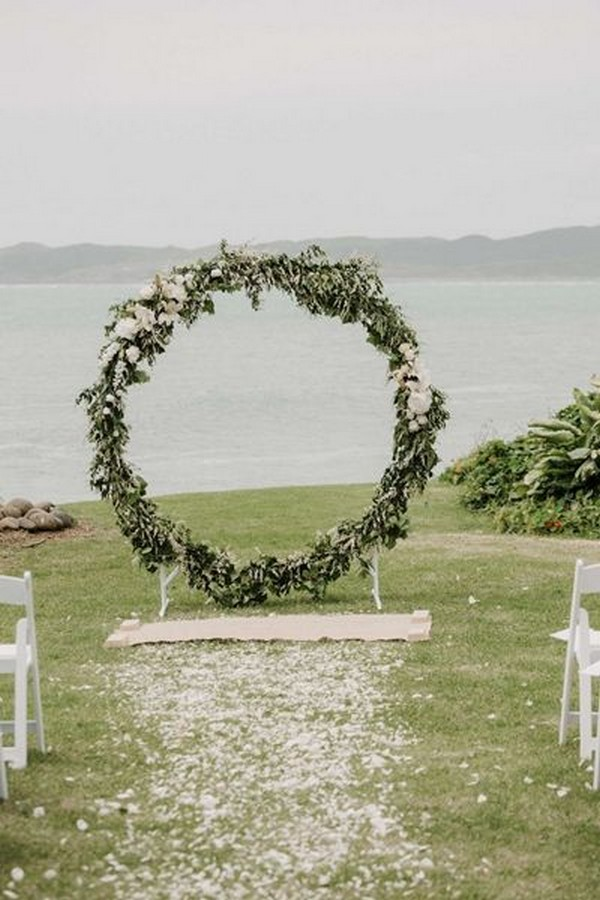 circular greenery ceremony wedding arch
