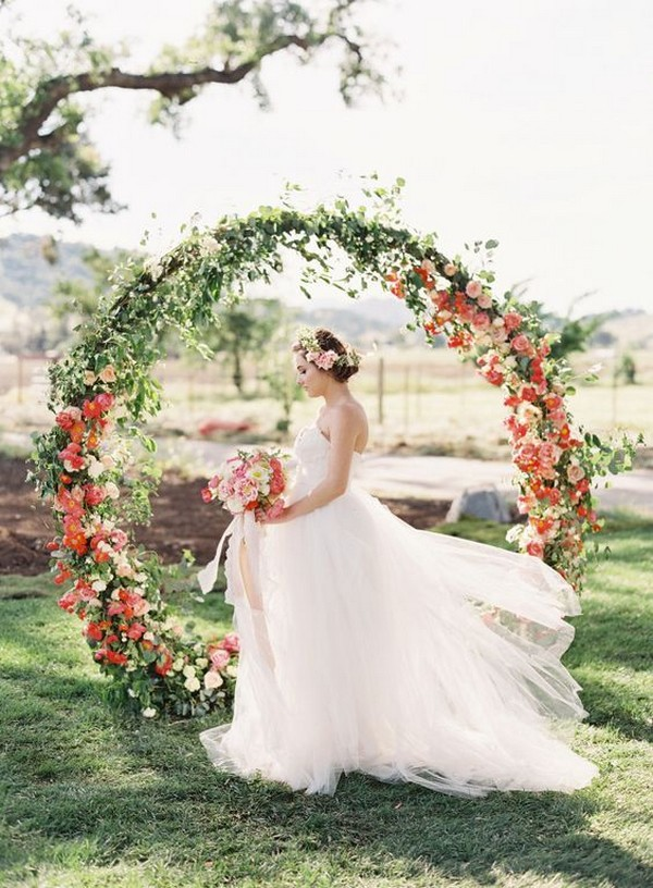 flower and greenery circular wedding arch ideas