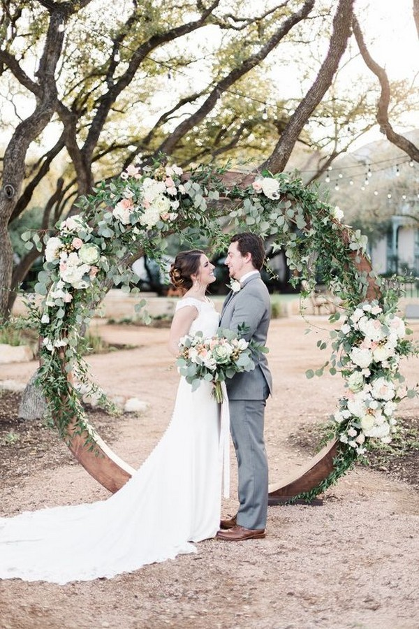garden themed floral and wood circular wedding arch