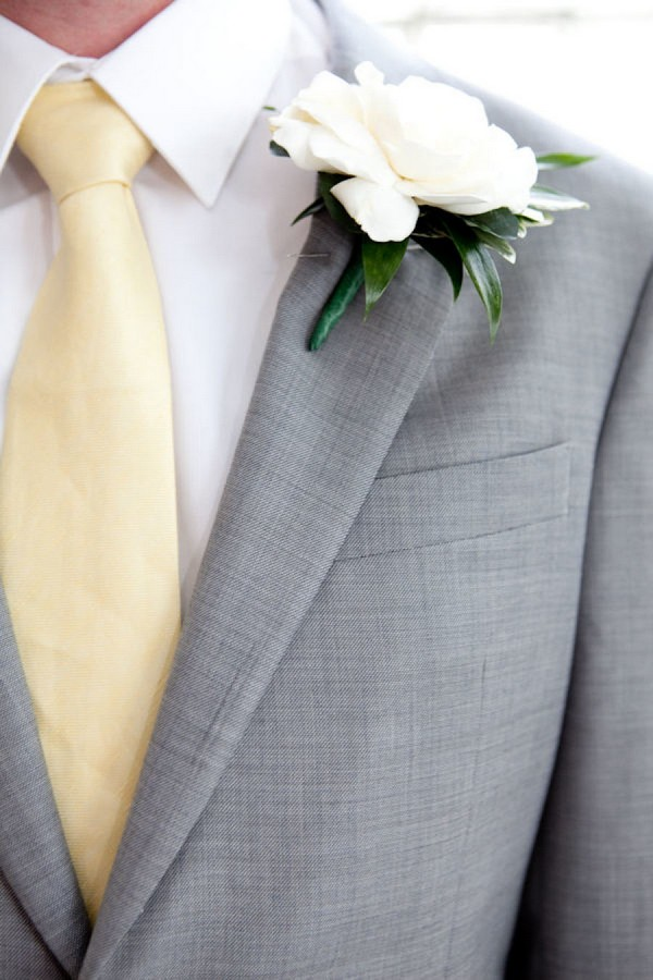 grey and gold groom attire