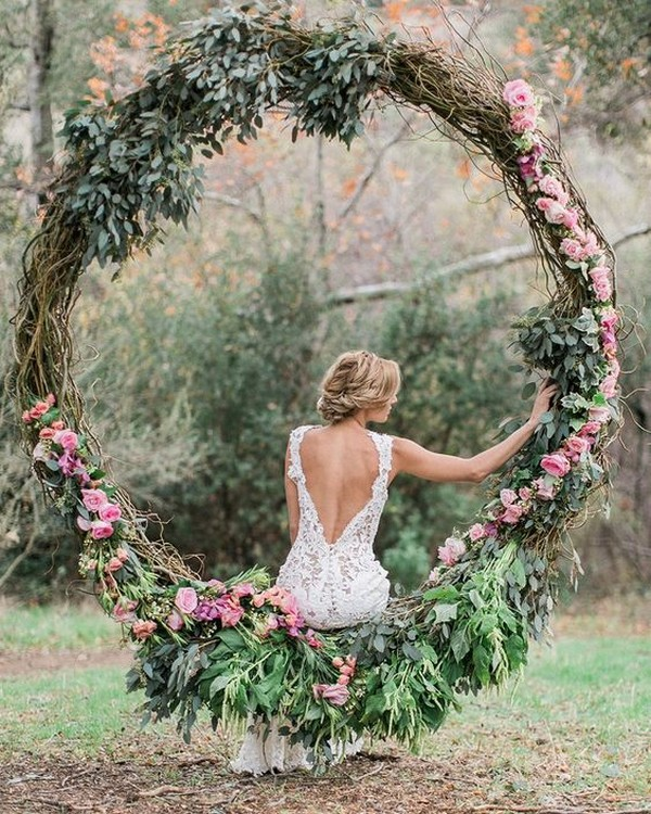 pretty floral wreath wedding arch
