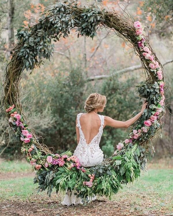 pretty floral wreath wedding arch