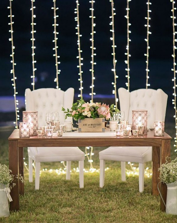 vintage sweetheart table decoration ideas with string lights backdrops