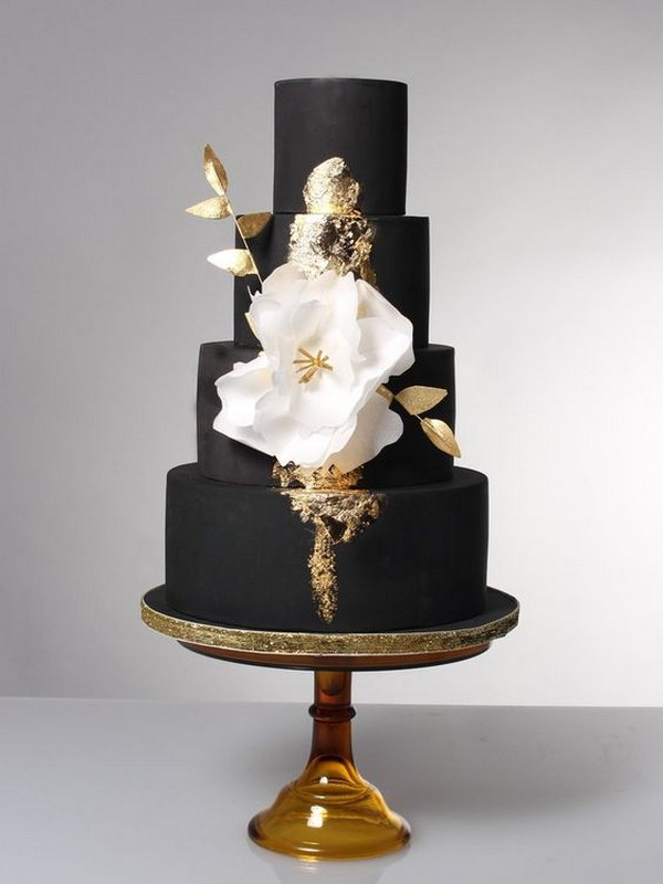black and gold wedding cake with fantasy flower