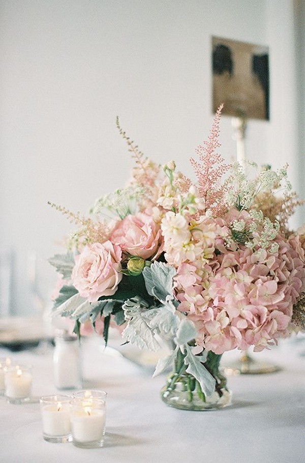 blush pink elegant wedding centerpiece with candles