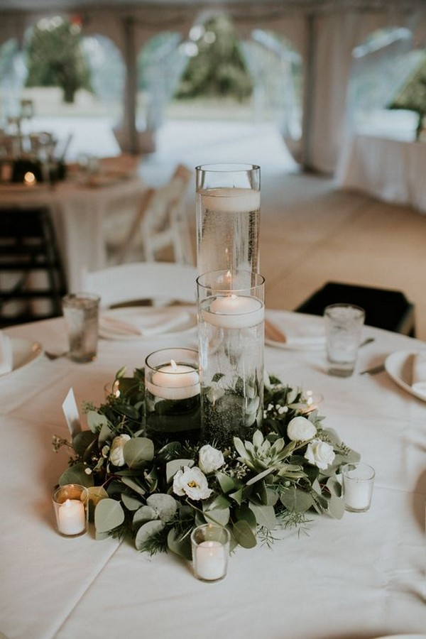 elegant greenery wedding centerpiece with floating candles