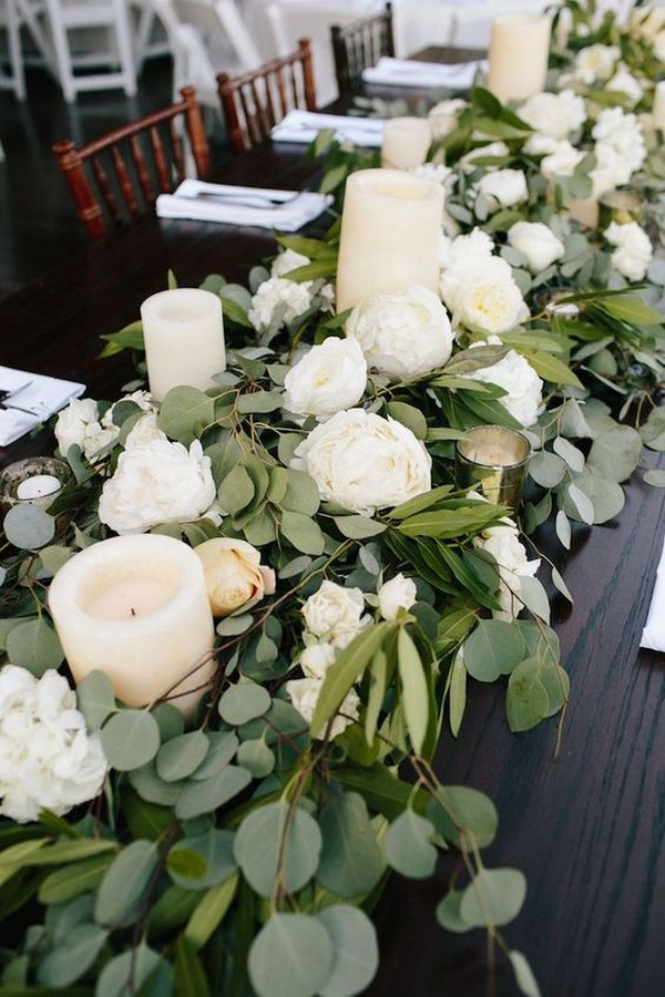 greenery and candles elegant wedding centerpieces