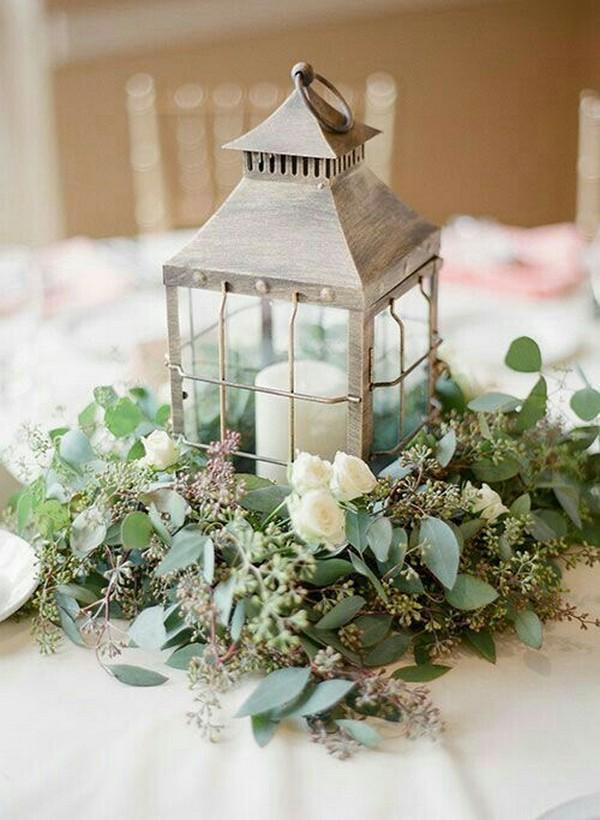 greenery wedding centerpiece with lantern