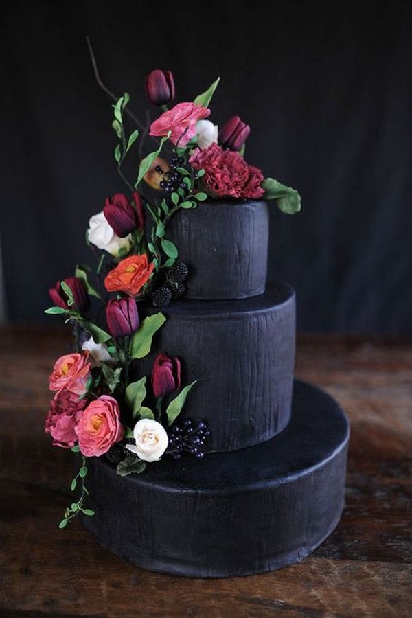 matte black wedding cake with pink flowers