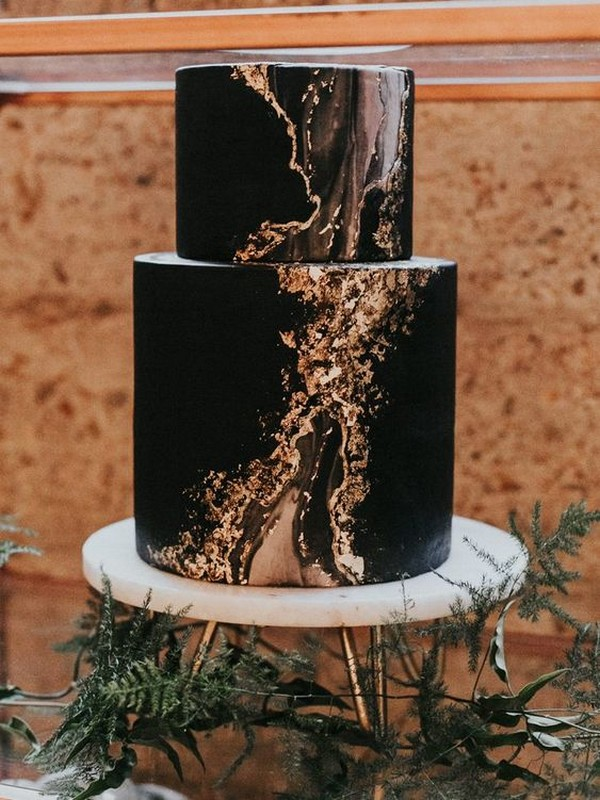 modern moody look black wedding cake with marble details
