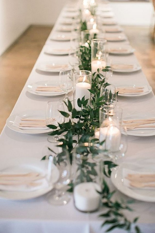 simple and elegant wedding centerpiece with greenery and candles