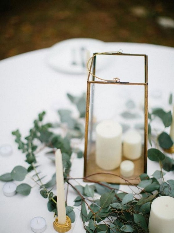 wedding centerpiece with greenery and lantern