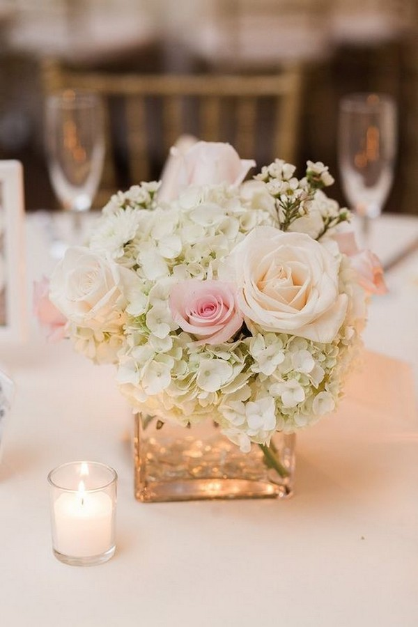 white and pink elegant wedding centerpiece with candles