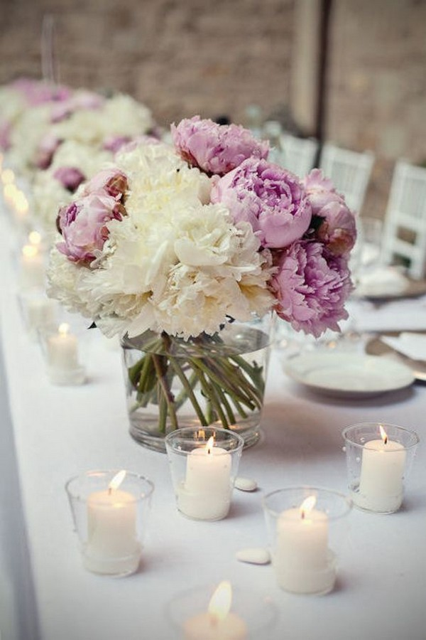 white and purple wedding centerpiece with candles