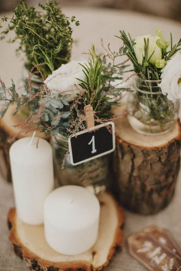boho wedding centerpiece with candles and tree stumps