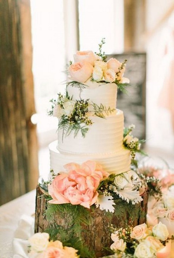 chic floral wedding cake with tree stump stand