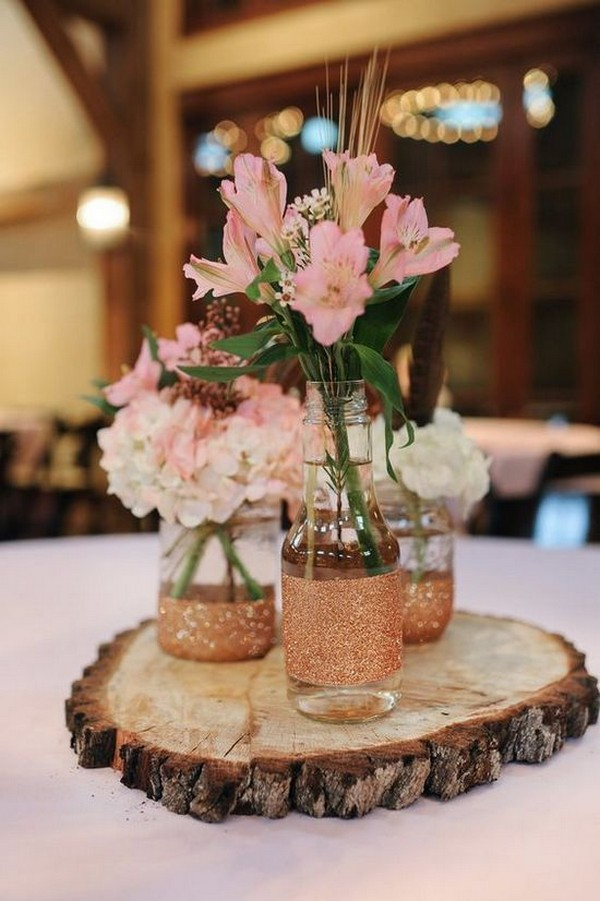 chic rustic wedding centerpiece with tree stump