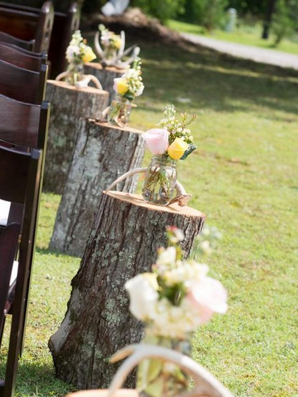 country wedding aisle decoration ideas with tree stumps