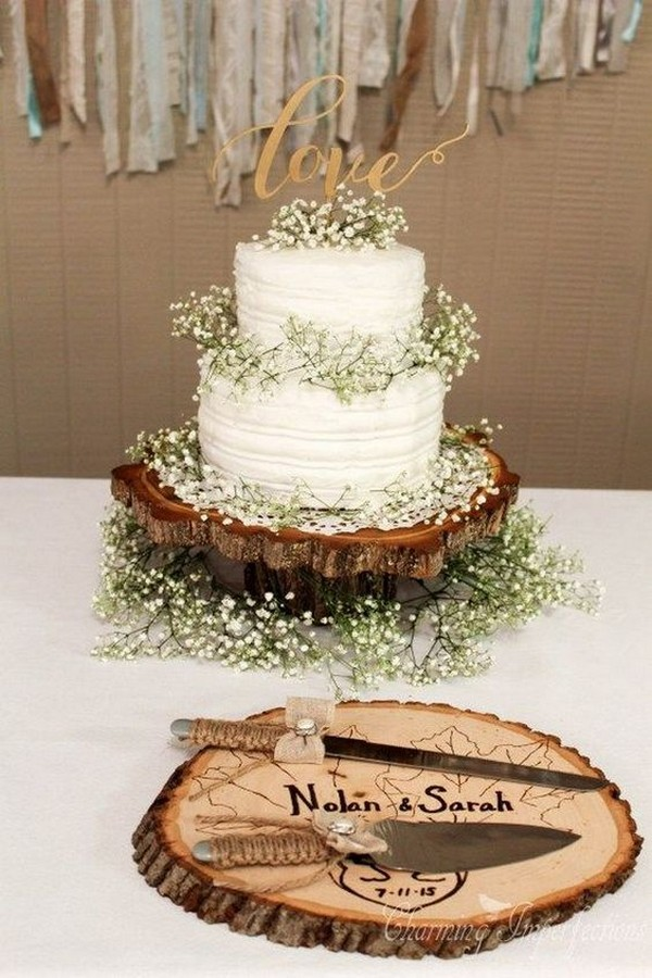 country wedding cake with baby's breath and tree stump