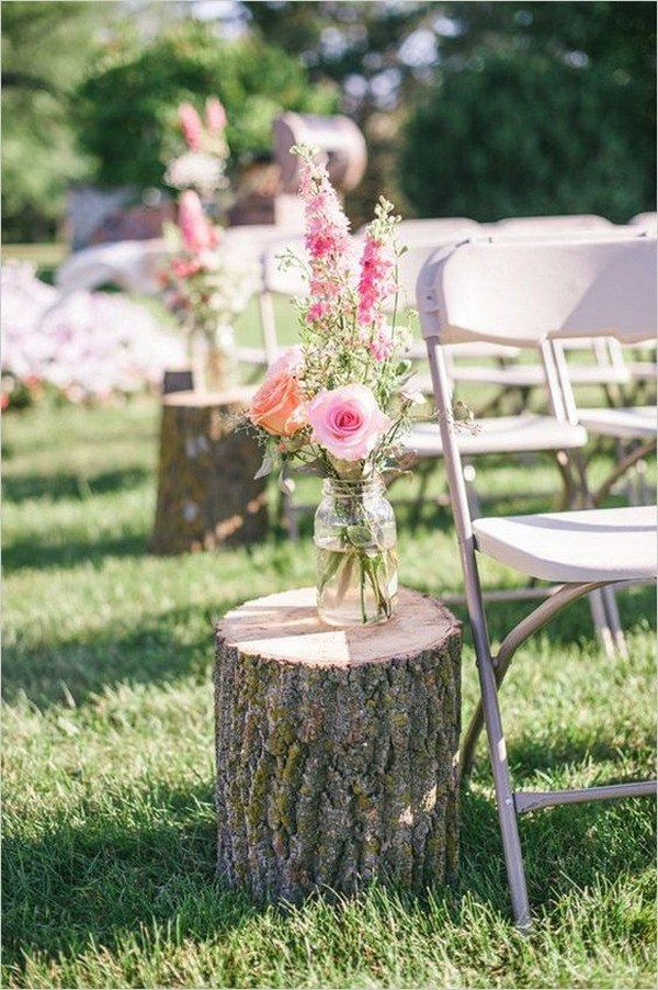 outdoor wedding aisle decorations with tree stumps