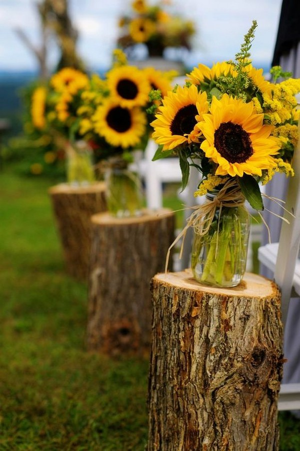 rustic sunflower wedding aisle ideas with tree stumps