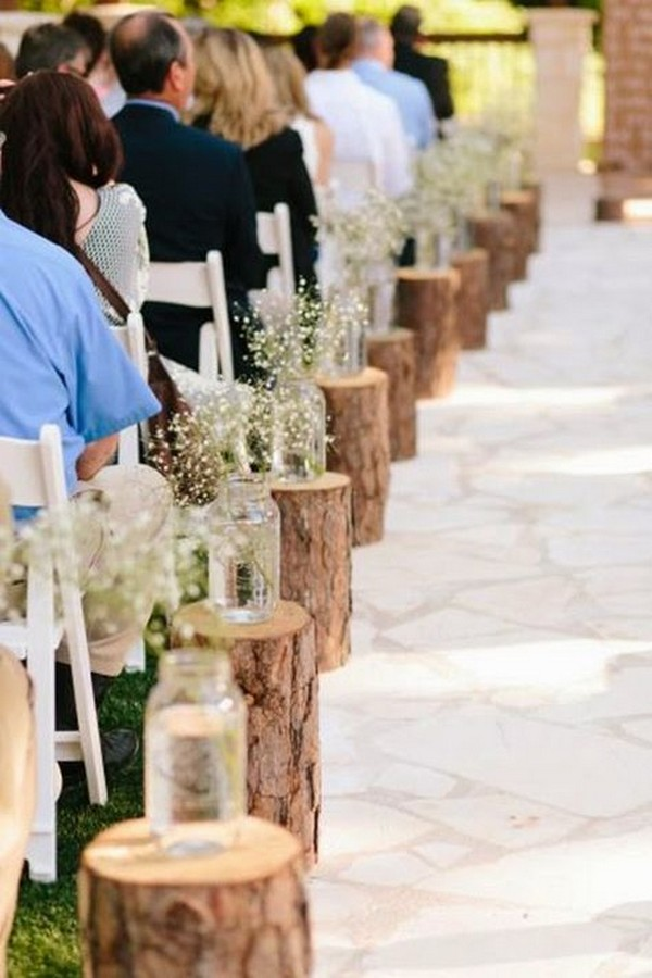 rustic wedding aisle ideas with tree stumps