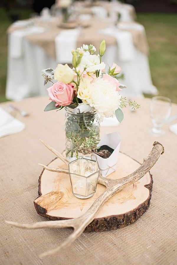 rustic wedding centerpiece with tree stump