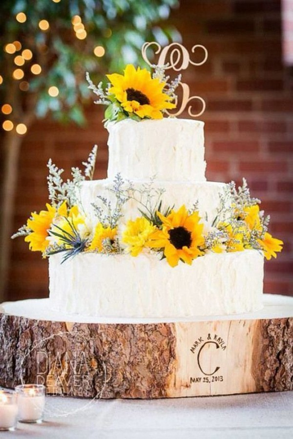 sunflower wedding cake with tree stump stand