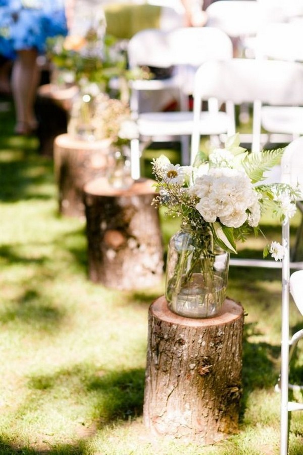 wedding aisle decoration ideas with tree stumps