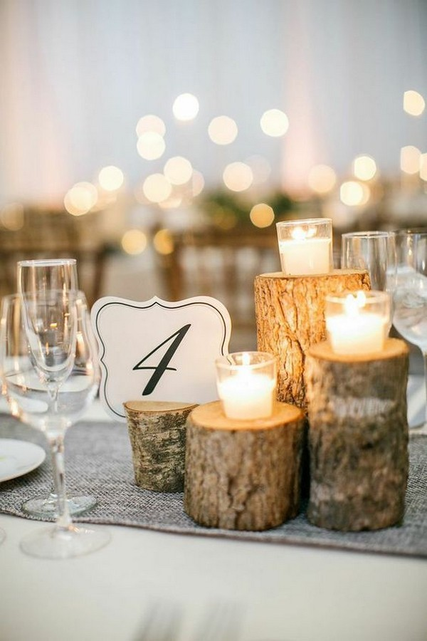 winter wedding centerpiece ideas with candles and tree stumps