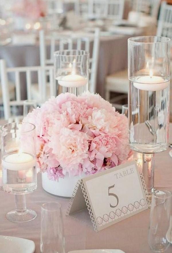 blush pink elegant wedding centerpiece with floating candles