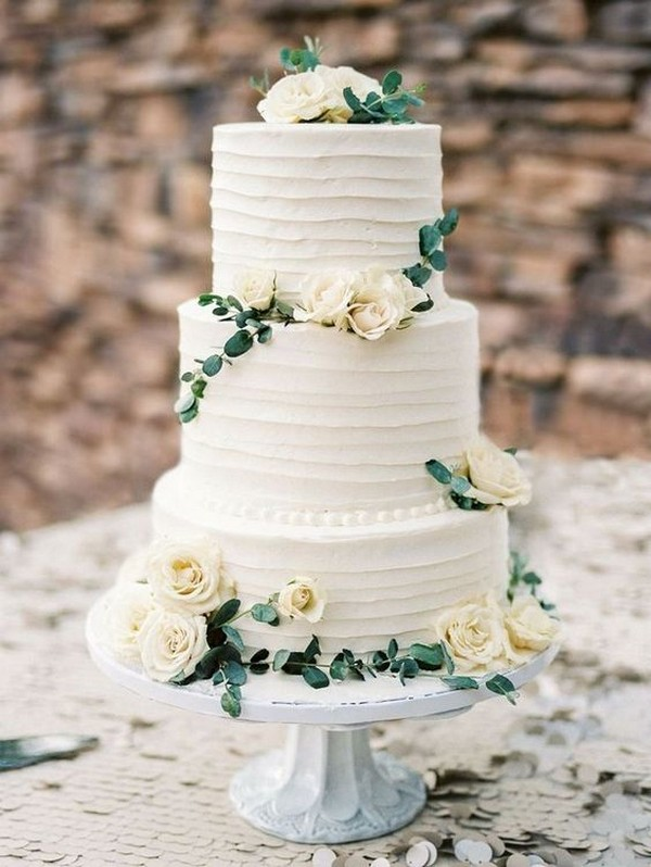 elegant white and green wedding cake
